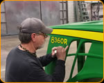 "One of the legends of pinstriping Casey Kennell stripping on the ""Bootlegger"" pulling tractor"